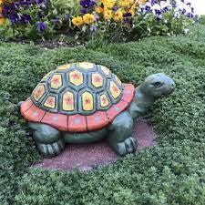 concrete statues garden turtle hand