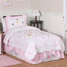 soft pink and white ballerina bedding set on the bed