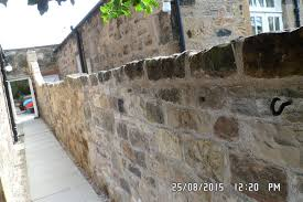 we lay new concrete founds and rebuilt using lime mortar and paid attention to the style of the build using the saved good stone with a makeup of new to