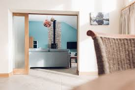 oak framed sliding pocket door with opaque glass panes in an award winning house by south