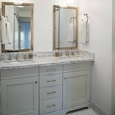 white bathroom cabinets with granite. gray bathroom with penny tile floor white cabinets granite y