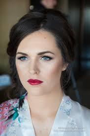 brunette bridesmaid makeup blue eyes dramatic false lashes canberra wedding makeup