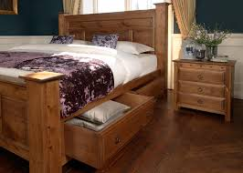 traditional wooden bed with storage drawers and bedside cabinet