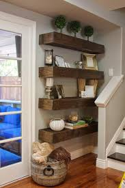 floating shelves are a great choice for a small space in your living room like the corner next to your stairs