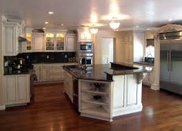 Shabby White Wooden Kitchen Cabinet With Black Countertops Connected