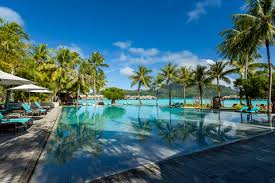 the intercontinental bora bora resort and thelasso spa is romantically located on motu piti aau two hearts in polynesian on the barrier reef between the