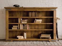 Terrific Unfinished Oak Low Bookcase Over Stones Floors And White Subway  Brick Wall Panels As Inspiring Traditional Interior Furnishings Ideas