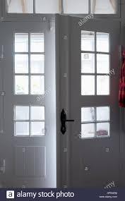 double door open. White Open Double Porch Glass Door Cottage Handle - Stock Image C