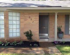 Small Picture Dark green shutters and beige paint with orange brick For the