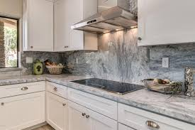 Entrancing White Kitchen Cabinets With Granite Countertops Painting  282018 In Arabescus Marble Counter Gray Streaks And  White Cabinets With Marble Countertops7