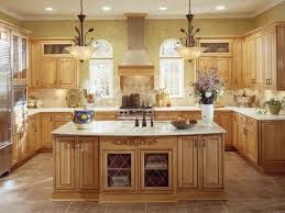 light brown thomasville kitchen cabinet with white solid countertop on ceramice tile floor