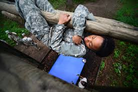 u s department of defense photo essay  army spc mykia ward maneuvers over and under wooden logs of the weaver obstacle