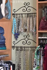 use towel racks and curtain s hooks to organize necklaces
