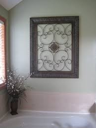 pictures for bathroom wall decor. wrought iron art work above the jacuzzi tub. perfect for couples bathroom. pictures bathroom wall decor pinterest