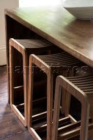 three stools under dining table