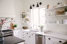 White kitchen Stainless Steel Clean White Kitchen Cabinets With Black Hardware In Minimalist Kitchen Designing Idea White Kitchen Cabinets Versatile Designs And Styles Youll Love