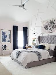 modern glam bedroom with gray tufted headboard love the blending of modern and glam with