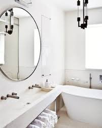 modern round bathroom mirror. Interesting Mirror A Former Warehouse Turned Into An Elegant Eclectic Home  Freestanding  Tub Modern Sink Round Mirror In Modern Round Bathroom Mirror N