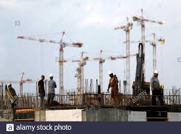 Labourers work at a construction site in the new neighbourhood of Carmei  Gat in the southern Israeli city of Kiryat Gat November 1, 2016. Picture  taken November 1, 2016. REUTERS/Amir Cohen Stock Photo - Alamy