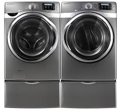 samsung washing machine and dryer. samsung wf520abp steam washer with power foam and dv520aep front load electric dryer around $3,098 for the pair. washing machine