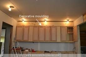 cabinet top lighting. wall of cabinets finishing the top 3 cabinet lighting e