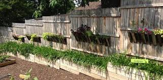 fence on a slope. fence built on sloping ground with planters a slope c