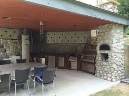 Metal Roof Completes Houston Modern Outdoor Kitchen - Modern outdoor kitchens