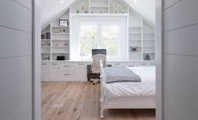 bedroom with painted wood paneling using shiplap wall board look
