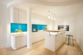 view in gallery turquoise back painted glass backsplash steals the show here