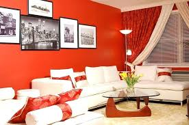 red wall living room decorating ideas small living room with red walls and table by design