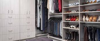 deluxe women s walk in closet with arctic shelves and cabinets