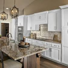 kitchens with white cabinets. Exellent White White Cabinets Kitchen Cabinetry Dark Island Granite Crown Molding Inside Kitchens With White Cabinets A