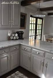These are the actual paint colors for this kitchen: Darker Gray Cabinets  with Marble Cabinet Color- Winter's Gate in Semi-Gloss by Benjamin Moore  Wall ...