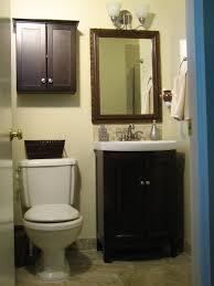 dark brown polished wodoen wall mount bathroom cabinet with door panel and round metal door knobs brown bathroom furniture