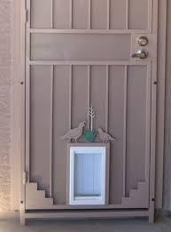 exterior door with window and dog door. griffiths - doggy door on security door.52 exterior with window and dog