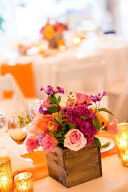 colorful centerpiece in a cool rustic wooden box