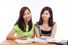 Two young Asian woman studying on the desk — Stock Photo © hans3513  #17626271