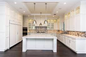 images of kitchens with white cabinets and wood floors