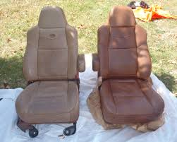 a picture of two car seats one faded and discolored the other red to car seat repair