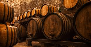 stacked oak barrels maturing red wine. Winemakers Need To Think Big Instead Of Chasing Trends In The Cellar   VinePair Stacked Oak Barrels Maturing Red Wine