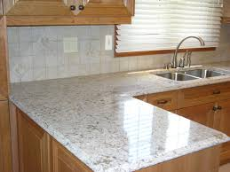 quartz countertop and tiled backsplash kitchen