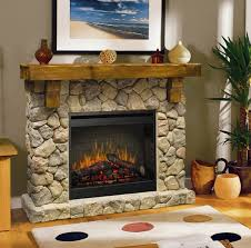 interior beige stone fireplace with brown wooden mantel shelf and black metal firebox connected by