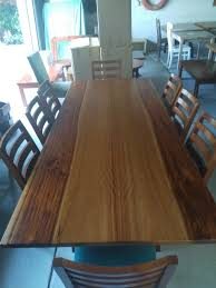 heavily featured 2 tone top camphor dining table