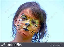 celebration little girl portrait with face paint of lion
