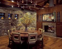 dining room round glass table set natural pine finish tabletop exposed brick stone fireplace turned