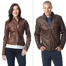 woman wearing brown faux leather jacket with white shirt and dark denim and man wearing brown