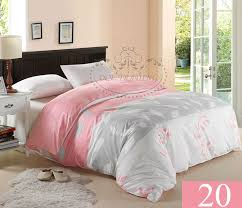 modern bedroom with pink silver king size bed duvet cover dark wood headboard king
