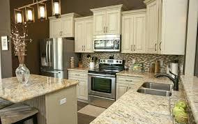 antique white kitchen cabinets with dark granite green countertops