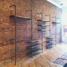 shelving in front of an exposed brick wall adds a sophisticated touch to any storage area looking to add brick to your home