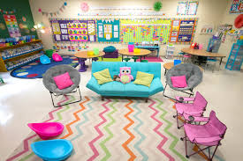 a colorful classroom with couches collapsible desks and scoop chairs